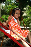 Menina asiática feliz na corrediça Foto de Stock Royalty Free