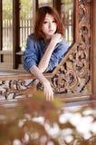 Menina asiática no outono Imagens de Stock Royalty Free