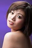 Menina asiática no roxo Foto de Stock