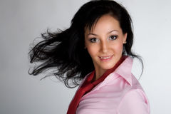 Menina asiática nova com o grande cabelo fly-away Imagem de Stock