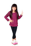Menina asiática pequena de sorriso que está guardando algo Fotografia de Stock