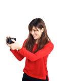 Menina asiática que toma a foto com uma câmera compacta Fotos de Stock