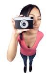 Menina asiática que toma um instantâneo Fotografia de Stock