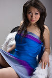 Menina asiática 'sexy' na cadeira Imagens de Stock