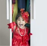 A menina asiática veste-se acima no vestuário Imagem de Stock Royalty Free