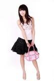 Menina asiática com bolsa cor-de-rosa Fotografia de Stock Royalty Free