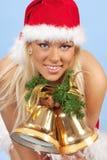 Menina assistente de Santa com sinos Foto de Stock Royalty Free