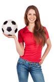 Menina nas calças de brim com bola de futebol fotografia de stock royalty free