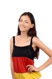 Menina atrativa com a blusa da bandeira de Alemanha Fotografia de Stock Royalty Free