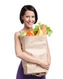 Menina atrativa com o pacote de fruta Imagens de Stock Royalty Free