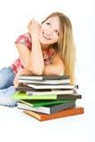 Menina atrativa do estudante com a pilha dos livros fotos de stock