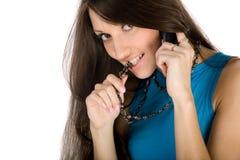 Menina atrativa nova com telefone fotografia de stock