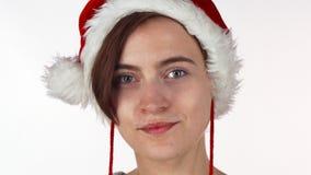 Menina atrativa nova do Natal que olha chocada ou surpreendida filme