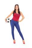 Menina atrativa que guarda um futebol Imagens de Stock Royalty Free