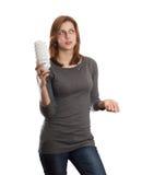 Menina atrativa que guardara um tubo fluorescente Fotografia de Stock Royalty Free