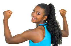Menina atrativa que mostra seus músculos Fotografia de Stock Royalty Free