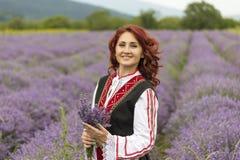 Menina búlgara em um campo da alfazema imagens de stock royalty free