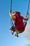 A menina balanç no céu Imagens de Stock Royalty Free