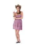 A menina bonita é chapéu do vestido e de palha do verão Imagens de Stock