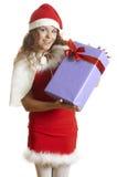 A menina bonita é surpreendida a um presente do Natal Foto de Stock Royalty Free