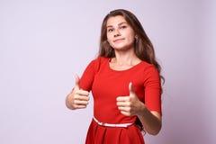Menina bonita Aprovaçã0 do gesto classe Brunette do retrato imagem de stock royalty free