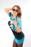 Menina bonita com óculos de sol Fotografia de Stock
