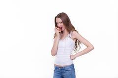 Menina bonita com Apple em um fundo branco Fotografia de Stock Royalty Free