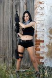 Menina bonita com arma Imagem de Stock Royalty Free