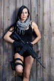 Menina bonita com arma Foto de Stock
