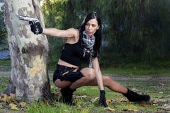 Menina bonita com arma Imagens de Stock