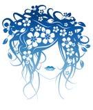 Menina bonita com as flores no cabelo Foto de Stock