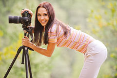 Menina bonita com câmera Fotos de Stock
