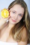 Menina bonita com citrino Imagens de Stock