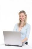 Menina bonita com computador Fotos de Stock Royalty Free