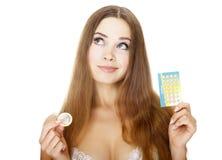 Menina bonita com contraceptivos Fotos de Stock Royalty Free