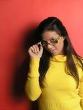 Menina bonita com eyeglasses Fotografia de Stock