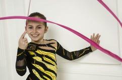 Menina bonita com a fita cor-de-rosa da ginástica rítmica Fotografia de Stock Royalty Free
