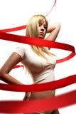 Menina bonita com a fita vermelha do cetim Imagem de Stock