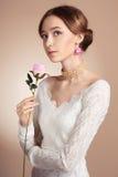 Menina bonita com flor Foto de Stock