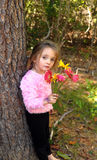 Menina bonita com flores Imagens de Stock Royalty Free