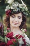 Menina bonita com flores Imagem de Stock Royalty Free