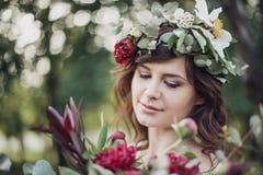 Menina bonita com flores Foto de Stock