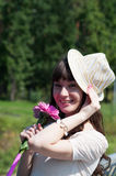 Menina bonita com flores coloridas Imagens de Stock Royalty Free