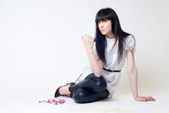 Menina bonita com grânulos Fotos de Stock