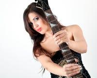 Menina bonita com guitarra Imagem de Stock
