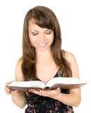 Menina bonita com livro imagens de stock