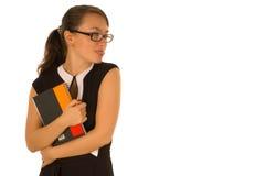 Menina bonita com o copy-book que mostra a lingüeta Fotos de Stock
