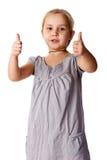 Menina bonita com polegares acima fotografia de stock royalty free