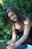 Menina bonita com portátil Fotos de Stock Royalty Free
