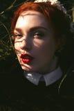 Menina bonita com redhair encaracolado Fotografia de Stock Royalty Free